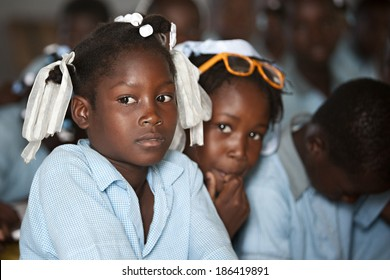 KOLMINY, HAITI - FEBRUARY 12, 2014 - Haitian student in class.  Shallow depth of field with focus on the girl in the front.