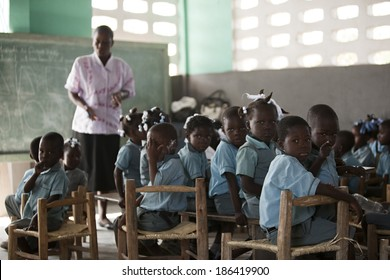 KOLMINY, HAITI - FEBRUARY 12, 2014 - Haitian classroom.  Shallow depth of field with focus on boy in the front on the right.