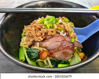 Kolo mee, mee kolo or mee halilintar in Malaysia is a type of Sarawakian noodle dish, characteristically light and tossed in a transparent sauce.Kolo mee is a Sarawakian Chinese favourite - Shutterstock ID 1853103679