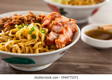 A Kolo Mee is a Sarawak Malaysian dish of dry noodles tossed in a savoury pork and shallot mixture, topped off with fragrant fried onions. - Shutterstock ID 1944771571