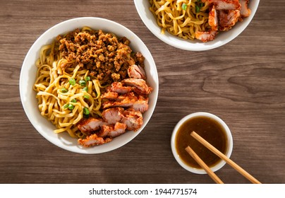 A Kolo Mee is a Sarawak Malaysian dish of dry noodles tossed in a savoury pork and shallot mixture, topped off with fragrant fried onions. - Shutterstock ID 1944771574