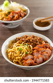 A Kolo Mee is a Sarawak Malaysian dish of dry noodles tossed in a savoury pork and shallot mixture, topped off with fragrant fried onions. - Shutterstock ID 1944771583