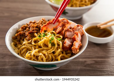 A Kolo Mee is a Sarawak Malaysian dish of dry noodles tossed in a savoury pork and shallot mixture, topped off with fragrant fried onions. - Shutterstock ID 1944935242