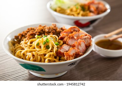 A Kolo Mee is a Sarawak Malaysian dish of dry noodles tossed in a savoury pork and shallot mixture, topped off with fragrant fried onions. - Shutterstock ID 1945812742