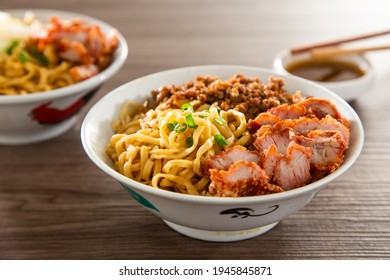 A Kolo Mee is a Sarawak Malaysian dish of dry noodles tossed in a savoury pork and shallot mixture, topped off with fragrant fried onions. - Shutterstock ID 1945845871