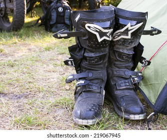 Kolobrzeg, Poland, August 03, 2014: motocross boots by Alpinestars brand near the tent.