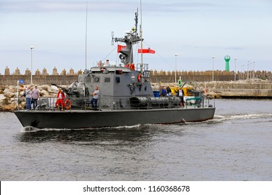 Kolobrzeg, Poland - June 11, 2018: The cruise ship Torpedo returns to the port from a coastal cruise on Baltic Sea. This torpedo boat had previously been taken out of service and adapted for cruises.