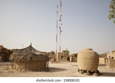 KOLOMBOUTEJ VILLAGE, NIGER - FEBRUARY 2013: Telecommunications antennas hanging over the village of Kolomboutej.