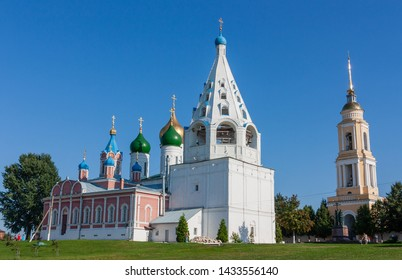 Kolomna, Russia - August 13, 2017: Cathedral bell tower of the Assumption Cathedral and the Temple of Icon of the Mother of God of Tikhvin against the background of the Assumption Cathedral