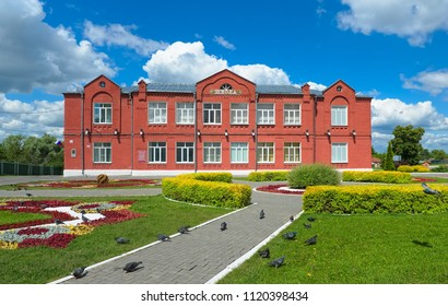 Kolomna, Russia - June 09, 2018: Main comprehensive school number 3 on the cathedral square in the city of Kolomna, the former parish council school, 1865