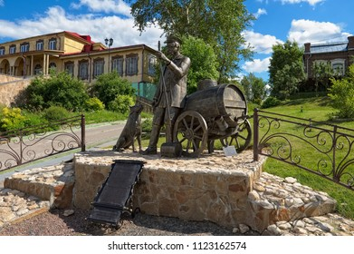 Kolomna, Russia - June 09, 2018: Monument to a water carrier (Vodovoz) on the Moskva River embankment, is installed on the site where in past centuries water carriers were collecting water from river