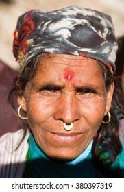 KOLTI VILLAGE, WESTERN NEPAL, 3rd DECEMBER 2013 - heat of nepalese woman, western Nepal near Kolti village