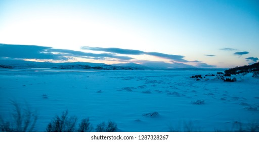 KOLVIK, NORWAY -MAR 2015 : sunrise on the icy sea of Porsangerfjord in Norway along the way to arrive at Honningsvag, circa March 2015.