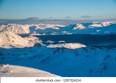 KOLVIK, NORWAY -MAR 2015 : view of snowy landscapes along the Porsangerfjord in Norway before arriving at Honningsvag, circa March 2015.