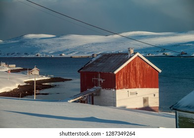 KOLVIK, NORWAY -MAR 2015 : a wooden house stands on the shores of Porsangerfjord in Norway along the way to Honningsvag, circa March 2015.