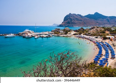 Kolymbia beach with the rocky coast in Greece.