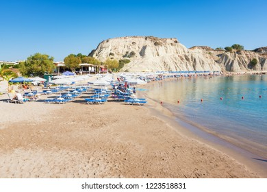 Kolymbia beach with umbrellas and sunbeds (Rhodes, Greece)