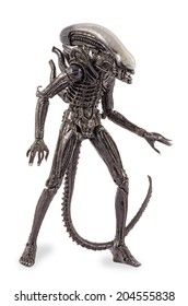 Komarom, Hungary - June 28, 2014: This is a 9 inches tall action figure by Neca Toys. This plastic model represents the monster from the original Alien movie (1979). / Attacking Alien