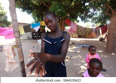 Kombo region, The Gambia, Africa, may 18, 2020, photography of a girl washing hands, outdoor on a sunny day