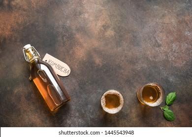Kombucha or cider fermented drink on rustic background, copy space. Heathy probiotic drink - kombucha.