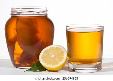 Kombucha superfood pro biotic beverage in glass on white background