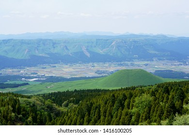 Komezuka of Aso mountain,Landscape of the Aso plateau in Japan,Aso city seen from the Outer ring mountain,