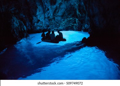 KOMIZA, CROATIA - AUG 15, 2009: The Blue Cave is one of Croatia's natural wonders, located on the eastern side of island Bisevo. The cave receives more than 90,000 tourist visits every year