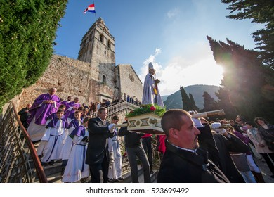KOMIZA, CROATIA - DEC 6, 2015: The tradition of devotion to St. Nicholas in Komiza is centuries old and culminates every year when a long procession is being held around the St. Nicholas church.
