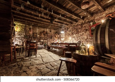KOMIZA, CROATIA - JUL 23, 2015: The word Konoba in Dalmatia means the room where food is prepared and stored. It is also used as a wine cellar.