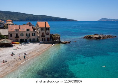 KOMIZA, CROATIA - MAY 14, 2018: Komiza is a romantic place full of ancient tastefully renovated stone houses by the sea and sand and pebble beaches.