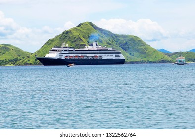 Komodo island, Indonesia, 01/09/2018, Volendam Cruise liner off the island. This liner is like a giant multi-storey city with all the amenities. Komodo national Park is located in the Indonesian archi