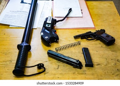 KOMSOMOLSK, RUSSIA - DECEMBER 1, 2018: a set of police officers, a shocker, a rubber baton, a Makarov pistol, a clip, documents on the table