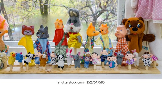 KOMSOMOLSK, RUSSIA - October 3, 2019: puppet theatre toys with the characters of fairy tales, Soviet and Russian cartoons, children's fun, bear Winnie the Pooh, hare Stepashka