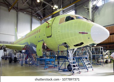 Komsomolsk-On-Amur / Russia - 08.16.2013. Assembly production of the Sukhoi Civil Aircraft. Final assembly line of aircraft Sukhoi Superjet 100. Airplane front view.