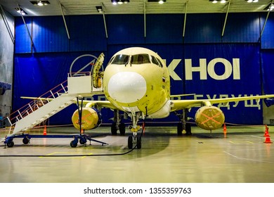 KOMSOMOLSK-ON-AMUR, RUSSIA — 1 March 2018: SСАC, Sukhoi Civil Aircraft Company, workshop where the fuselage of the  Superjet 100 is assembled, view of the plane with a ladder in front