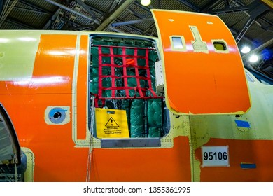 """KOMSOMOLSK-ON-AMUR, RUSSIA — 1 march 2019, SСАC, Sukhoi Civil Aircraft Company, workshop where the fuselage of the Superjet 100 is assembled. open door, sign """"danger"""""""