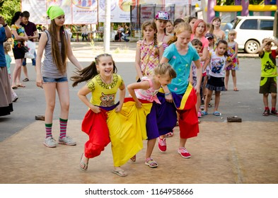 Komsomolsk-on-Amur, Russia - August 1, 2015. Public open Railroader's day. several children flee in sewn sacks at a pirate party during a city holiday