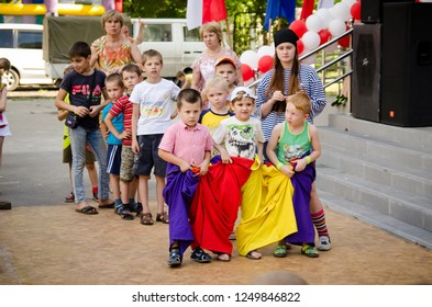 Komsomolsk-on-Amur, Russia - August 1, 2016. Public open Railroader's day. boys team ready to flee in sewn sacks at pirate party