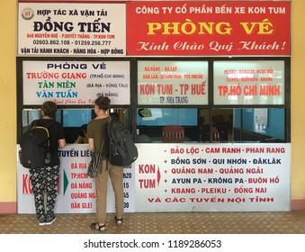 KON TUM, VIETNAM - SEPTEMBER 22, 2018: Two women buy bus tickets at a local bus station. The city is located in the Central Highlands region near the borders with Laos and Cambodia.