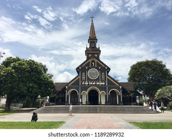 KON TUM, VIETNAM - SEPTEMBER 22, 2018: Cathedral of Kon Tum, a Roman Catholic wooden church. The city is located in the Central Highlands region near the borders with Laos and Cambodia.
