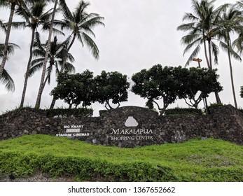Kona, Hawaii - October 19, 2018: Makalapua Shopping Center - Sign on Lava rock wall with Big Kmart, Macy's, Stadium Cinemas.