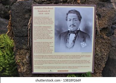 Kona, Hawaii / USA - April 24th 2019: Sign at the Kauikeaouli Kamehameha III birthplace with a brief history about himself and his family. Keauhou Bay, Big island of Hawaii.