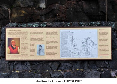 Kona, Hawaii / USA - April 24th, 2019: A Sign briefly describing the Kamehameha Dynasty, some notable area residents, and He'eia Bay. Big Island of Hawaii.