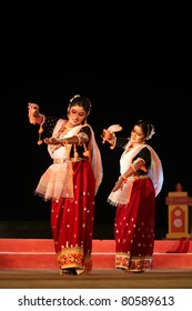KONARK, INDIA - DECEMBER 04: An unidentified group of professional folk dancers wear traditional costume and perform during national dance festival on December 04, 2010 at Konark, India