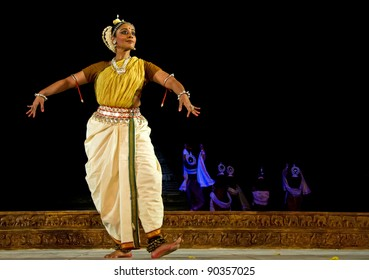 KONARK, INDIA - DECEMBER 04: An unidentified lady dancer wears traditional costume and performs Odissi dance at Konark temple on December 04, 2011 in Konark, Orissa, India