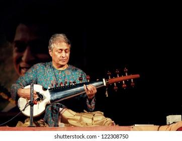 KONARK, INDIA - FEBRUARY 19: Famous classical musician Ustad Amjad Ali Khan plays Sarod during an annual festival at Konark temple on February 19, 2011 at Konark, Orissa, India