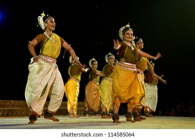 KONARK, INDIA - SEPTEMBER 24: An unidentified group of lady dancers wears traditional costume and performs Odissi dance at Konark temple on September 24, 2012 in Konark, Orissa, India