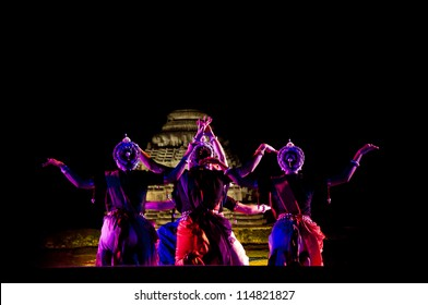 KONARK, INDIA - SEPTEMBER 24: An unidentified group of lady dancers wear traditional costume and perform Odissi dance at Konark temple on September 24, 2012 in Konark, Orissa, India