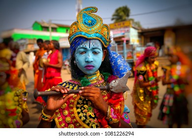 Konark, Odisha, India - January 10, 2014 - Portrait of a young boy dressed as Lord Krishna during traditional fair at konark.