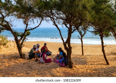 Konark, Odisha, India - January 10, 2014 - group of young people enjoying the Chandabhaga beach at Konark